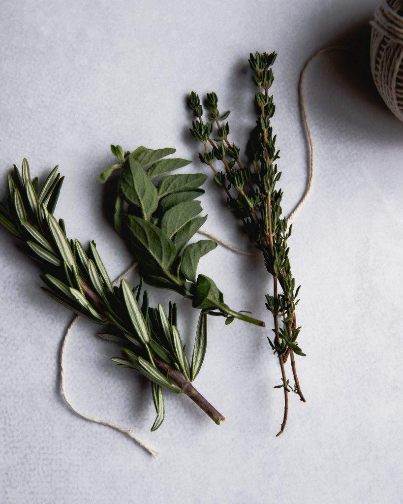 thyme, oregano, and rosemary along with a piece of kitchen twine