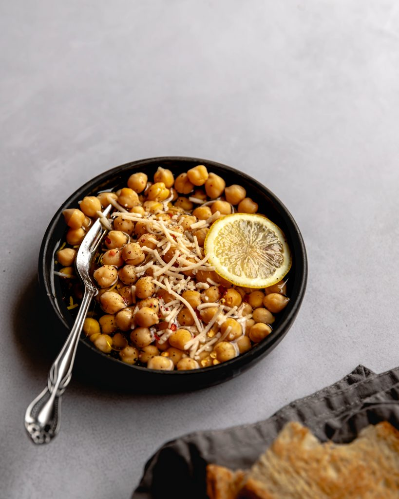 a bowl of chickpeas with lemon and parmesan