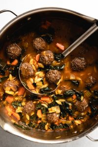 Inspired by a classic Italian Wedding Soup recipe, this cozy vegan soup features mini meatballs made from Impossible meat, a rich and savory tomato broth, fiber-rich kale, and tender orzo pasta.